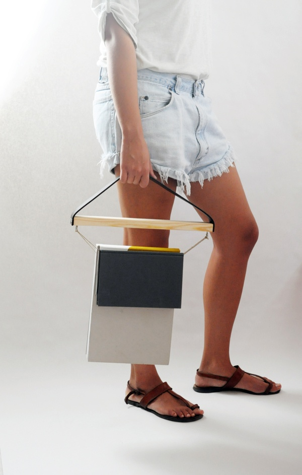 """Hang Bag by Michou Vasilis, via Behance    Hang bag is a handcrafted project. Its design is based on the idea of hanging books and other objects instead of using a usual bag. Objects and especially books  are easy to access, enabling you to find the """"contents"""" easily.    The re-use of an old belt and a useless piece of wood was also a challenge in this design."""