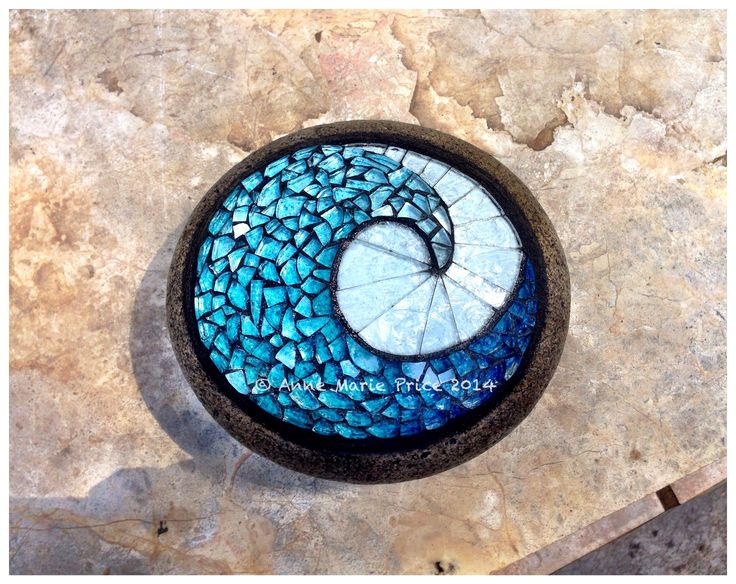 Wave mosaic on rock by Anne Marie Price. #mosaic #art #wave #AnneMariePrice #AMP #glass #garden #rock