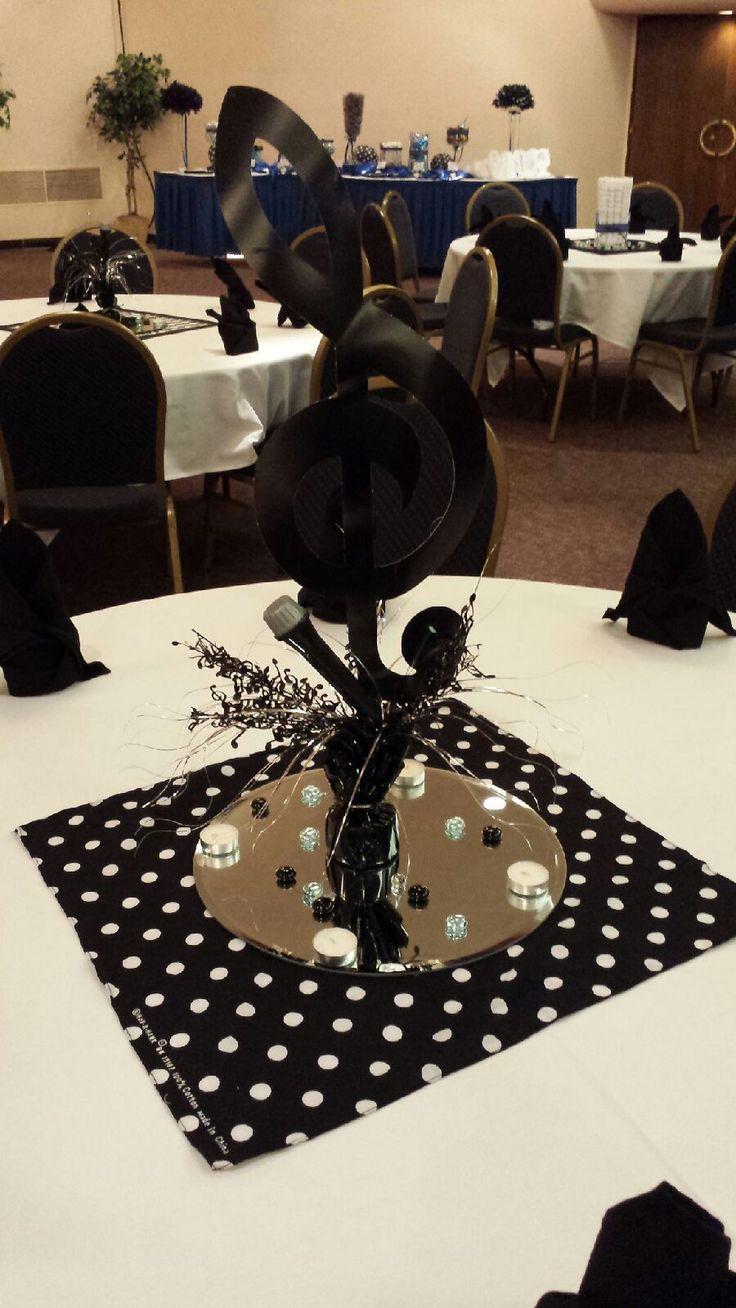 Choir banquet black and white centerpiece. Music note, mirror, glass pebbles, tea light candles. (quinceanera decorations black)