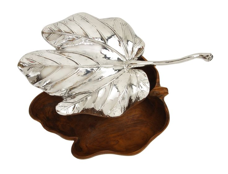 The art of carving leaves originates in ancient China and we uses master craftsmen to produce the miracles which comes very close to a real dried leaf in looks and in thinness, and it also has the precision to fit the bowl (or vise versa).   Sterling silver leaf shape lid with long stem is thoughtfully designed to cover nicely on the wooden bowl. This piece adds a distinctive touch of nature to any place around the house.