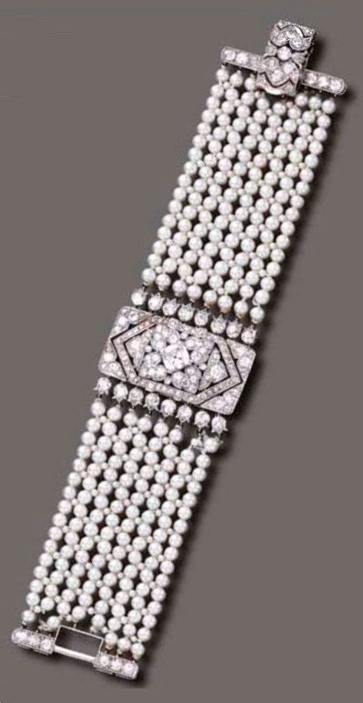 AN ART DECO PEARL AND DIAMOND BRACELET, BY CARTIER, CIRCA 1920. The wide pearl and seed pearl mesh band, centring upon a single, old European and old mine-cut diamond pierced rectangular panel, joined by a clasp of similar design, mounted in platinum, signed Cartier, numbered. From the Doris Duke Collection. #Cartier #ArtDeco #bracelet