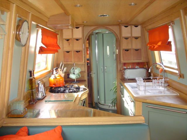 narrowboat s-shaped galley I like the pull out box shelving on the back wall. Needs labeling however.