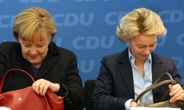 The German chancellor, Angela Merkel, and labour minister Ursula von der Leyen look inside their handbags at the beginning of a meeting with the leadership of their Christian Democratic Union (CDU) party in Berlin