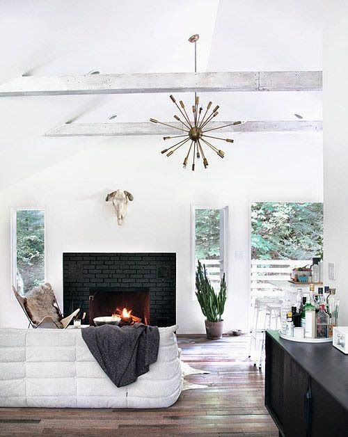 COCOCOZY: NEUTRAL ZONE - White living room black #brick #fireplace. Exposed beam pitched high ceiling.  Sputnik style chandelier. Love this room!
