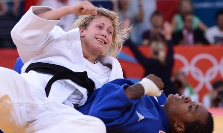 Britain's Gemma Gibbons reacts after winning against France's Audrey Tcheumeo (blue) during their women's -78kg judo contest semi-final match. Gibbons will now definitely get a gold or silver medal