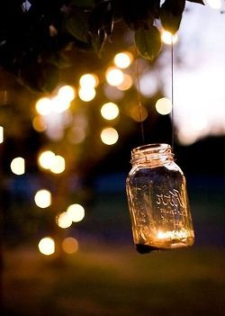 Love this placing old mason jars in the trees and hanging them like lights.... I seen this on TV recently down south on a show... they put tea lights or larger candles in these jars.... and strung them from rope with fishing line and it was so pretty!! If I lived in country again I would do this for sure for a party!! Heck I would do it just to have it and see it at night!!!