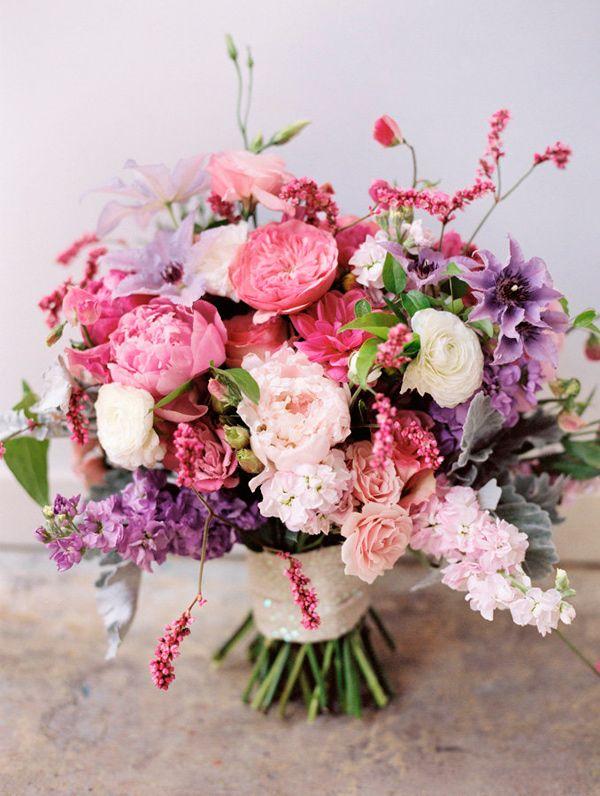 pink and purple bouquet, photo by Mikki Platt http://ruffledblog.com/barbie-inspired-wedding-ideas #flowers #weddingbouquet #peonies