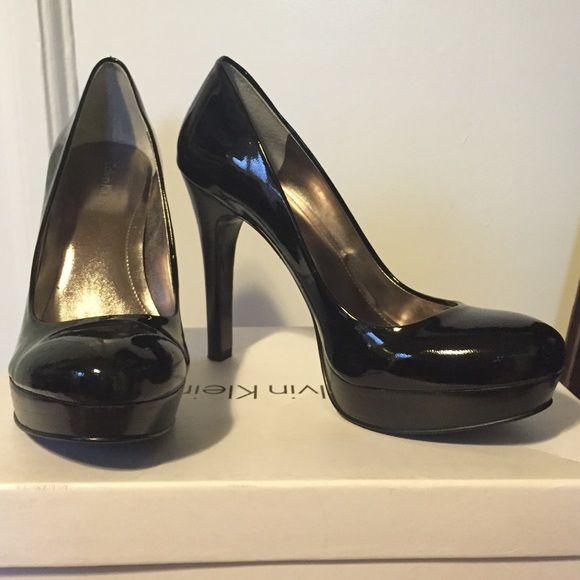 SALE TODAY ONLY Calvin Klein Pumps size 7 Calvin Klein black patent platform leather pumps in original box. Size 7. Worn two times indoors. Heel is too high for me but they are so so sexy. Calvin Klein Shoes Platforms