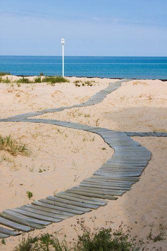 Winding boardwalk in the sand at Ludington, Michigan.