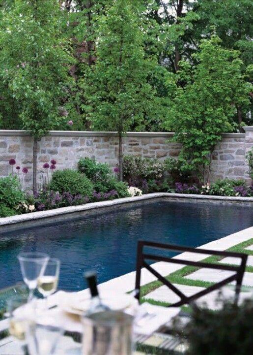 Stone wall behind pool