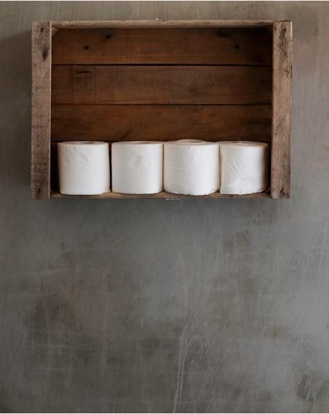 Spotted on Desire to Inspire, the Uruguay home of Heidi Lender, which includes a wall-mounted crate for toilet roll storage.