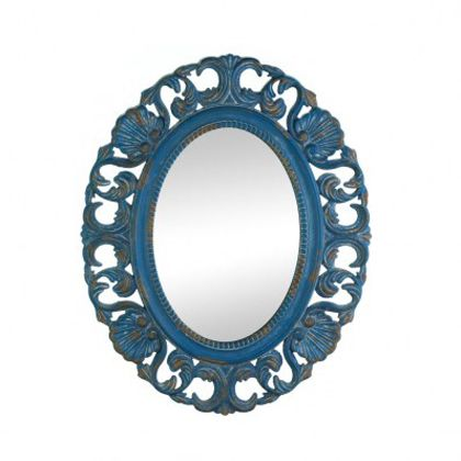 <p>Seashells and ornately carved waves surround this oval mirror with a splash of vintage charm. The wooden frame features a weathered blue finish that makes this wall-mounted mirror stand out in any room of your home. The color of this item may vary due to distressed finished.</p>