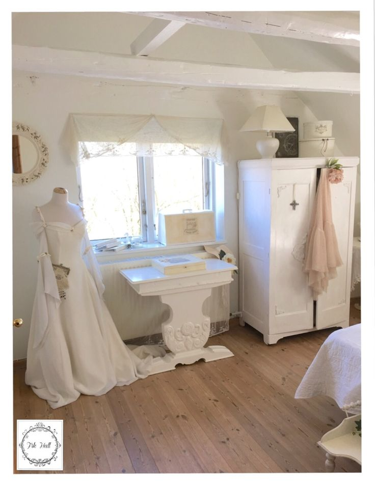 Old closet and white shabby chic furniture, and a beautiful romantic wedding dress