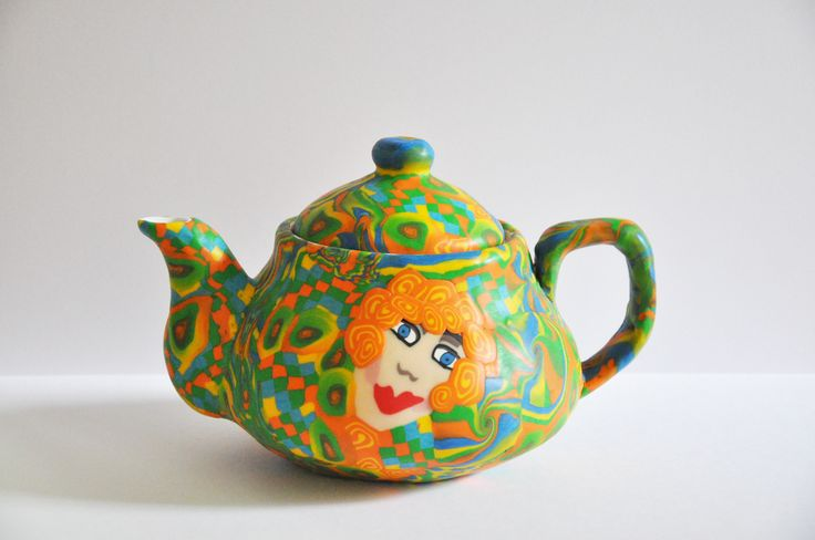 Tea pot made from polymer clay on porcelain