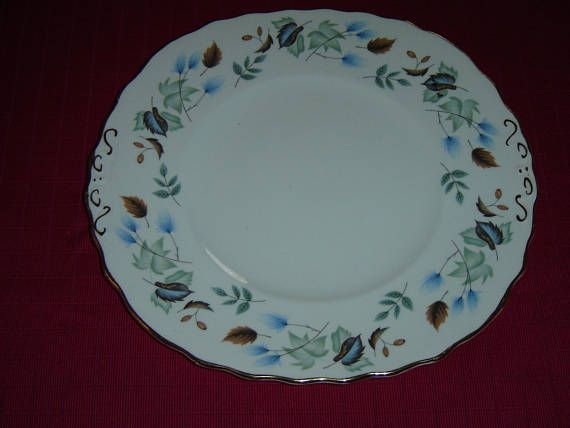 """Handled Square Cake Plate in the Linden pattern (#8162) by Colclough  This plate is 9 3/8"""" (23.8 cm) from side to side  This plate is numbered C 36 8  Made of bone china from England  The gold trim on the edge of the plate shows some wear (<10%) but the rest of the design is in like new condition    This item has no nicks, chips, cracks, or signs of repair 