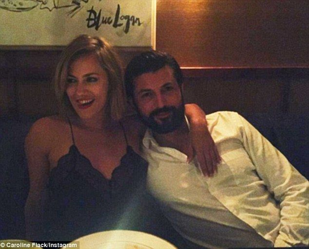 Single lady: Caroline Flack and her beau Blue Logan have quietly split, a source has told MailOnline - just three months after their public debut as a couple