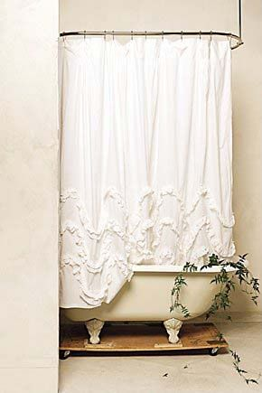 dreamy bathroom. love the ruffled shower curtain.