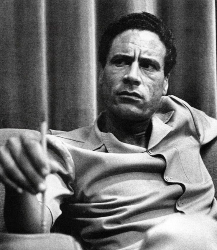 "Muammar Muhammad Abu Minyar al-Gaddafi [6] (Arabic: ﺮﻤﻌﻣ ﺪﻤﺤﻣ ﻮﺑأ رﺎﯿﻨﻣ ﻲﻓاﺬﻘﻟا /ˈmoʊ.əmɑr ɡəˈdɑːfi/ audio (help·info)) (c. 1942 – 20 October 2011), commonly known as Colonel Gaddafi, [nb 3] was a Libyan revolutionary and politician. Taking power in a 1969 coup d'etat, he ruled Libya as Revolutionary Chairman of the Libyan Arab Republic from 1969 to 1977 and then the ""Brother Leader"" of the Libyan Arab Jamahiriya from 1977 to 2011, when he was ousted in the Libyan civil war. Politically an…"