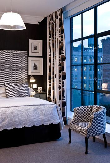 Crosby Street Hotel, New York. Bedroom in Black and white. Tall uphostered headboard. Photo by Gilles Trillard.