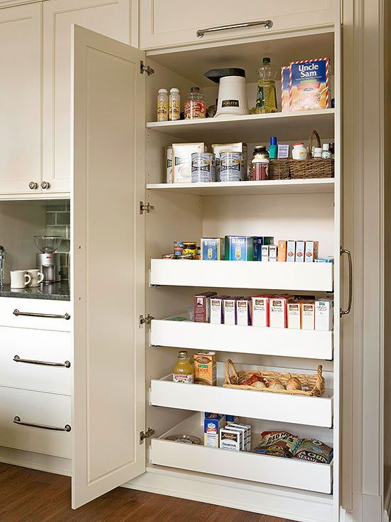 Replace conventional shelves with sliding drawers for easier access to your cooking essentials. Deep shelves on top and pullout drawers below offer abundant storage in a compact form and make it easy to do a quick visual inventory. White double doors match the kitchen's style and hide the collection of dry goods.