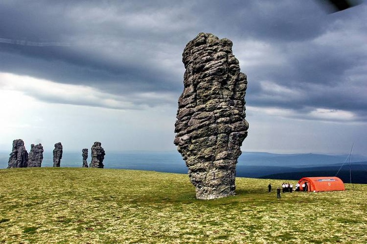 """2 - THE SEVEN STRONG MEN ROCK FORMATIONS  From Wikipedia:  """"The Manpupuner rock formations (Man-Pupu-Nyer; Мань-Пупу-нёр) or the Seven Strong Men Rock Formations or Poles of the Komi Republic are a set of 7 gigantic abnormally shaped stone pillars located north of the Ural mountains in the Troitsko-Pechorsky District of the Komi Republic. These monoliths are around 30 to 42 m high and jut out of a hilly plateau formed through the weathering effects of ice and winds."""""""