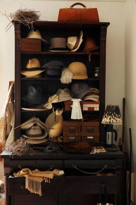 Vintage hats on bookcase