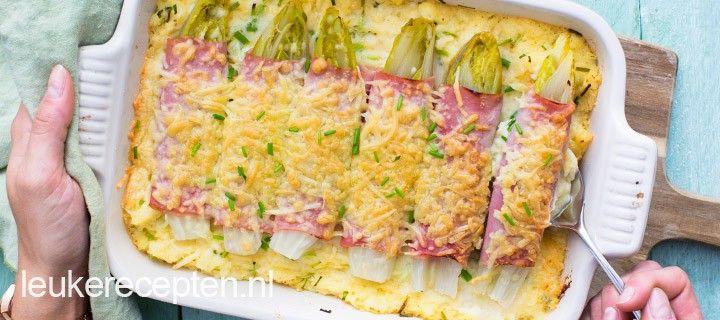 Lekkere winterse kost: romige aardappelpuree met bieslook met witlof rolletjes met ham en kaas
