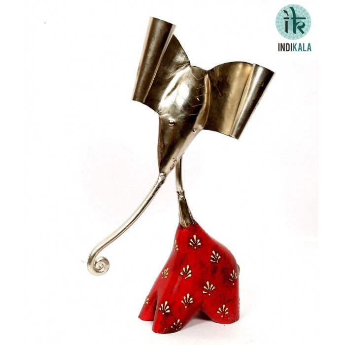 This figure of Ganesh Ji is believed to enhance positive vibes in its surroundings. An auspicous entry to your home décor collection.  Buy now at : http://www.indikala.com/new-additions/ganesh-ji-in-white-metal-and-wood.html  #Ganesha #Buy #Sell