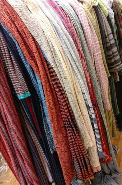 Piles of scarves waiting to be finished | McKernan Woollen Mills | Handmade in Ireland | Irish Design | Weaving & Knitting | Mens & Womens Accessories