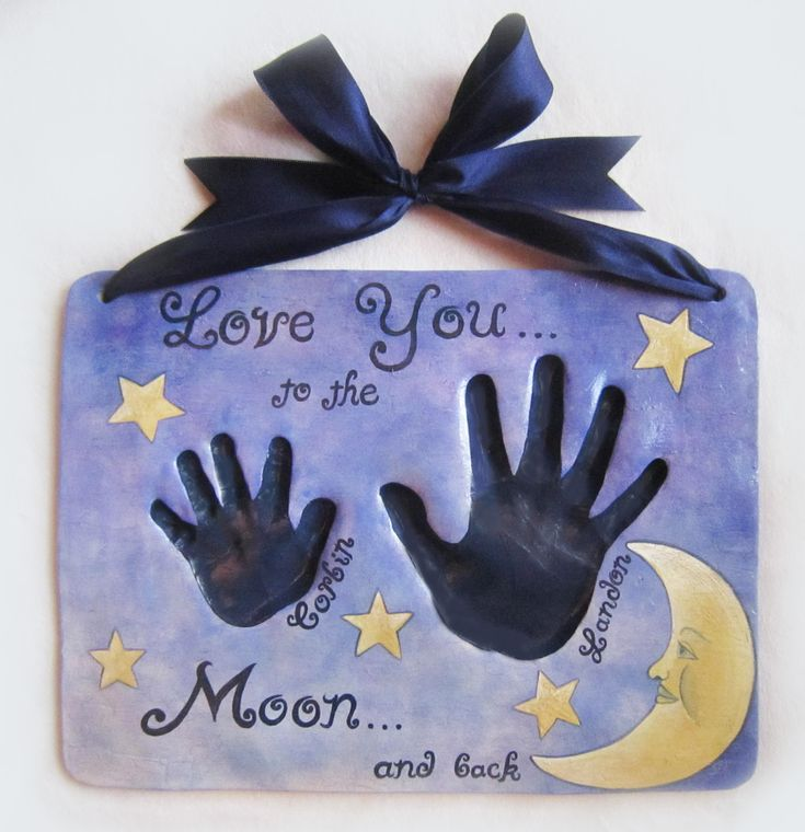 "Love you to the Moon and back. Baby hand & feet impression. Baby or child ceramic hand print heirloom quality keepsake. Visit and ""LIKE"" Mitts, Piggys & Paws Baby Hand & Feet Impressions plus pet paws by Amy Stone on facebook: www.facebook.com/... Mail order available! Visit us online: www.MittsPiggysPa... or email for appointment if local to the Memphis, TN area: mailto:Amy@MittsP..."