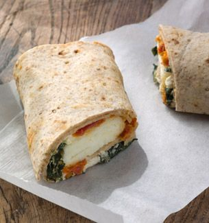 Copycat Starbucks Spinach  Feta Breakfast Wrap. A wheat wrap filled with egg whites, spinach, feta cheese and tomatoes.