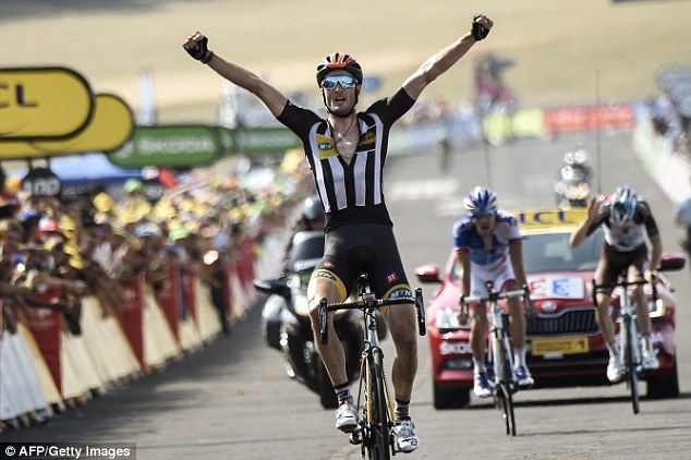 Britain's Steve Cummings raises his hands after winning the 14th stage at the Tour de France for team MTN-Qhubeka