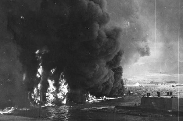 Oil burns on the waters of Pearl Harbor, near the naval air station, after the Japanese attack on Pearl Harbor on December 7, 1941.