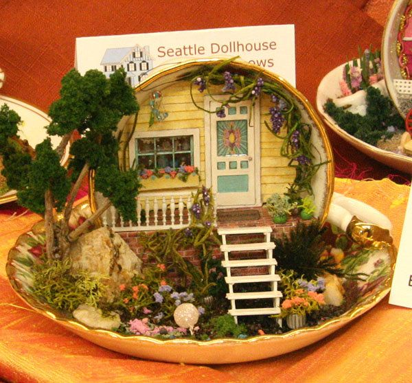 """¼"""" scale front porch scene in a Tea Cup by Abby Carlson, exhibited at the Spring 2010 Seattle Dollhouse Show"""