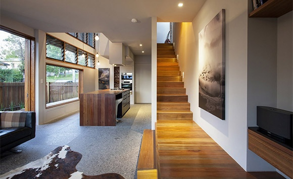 Torino granite flooring in kitchen area mixed with spotted gum timber flooring.  (eco-outdoor March)