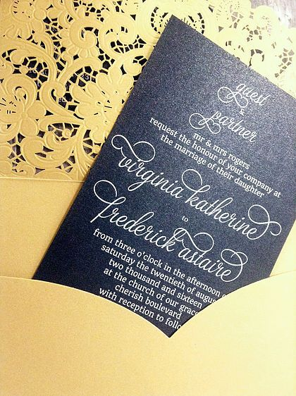 Traditional Lace laser cut invitation wallet in gold shimmer with invitation insert white ink printed on Cocktail Hour black shimmer card