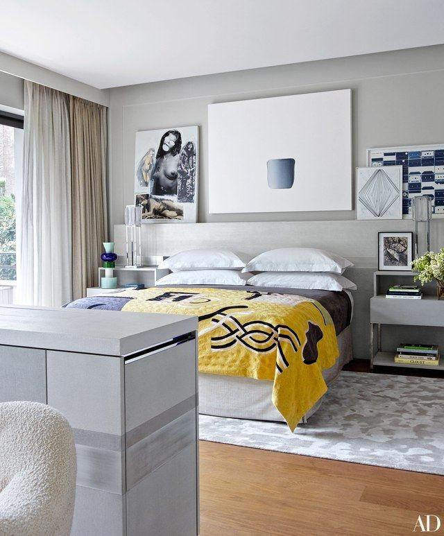 Among the master bedroom's artworks are pieces by Richard Prince (left) and Lee Ufan (center); the headboard, nightstands, and TV cabinet are all by Atelier Pierre Bonnefille, and the carpet is by Tai Ping.