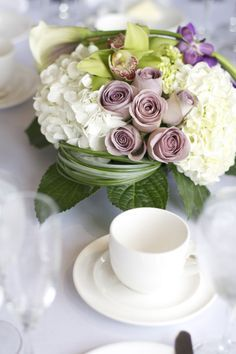 Refined elegance with dusty violet roses and white hydrangeas