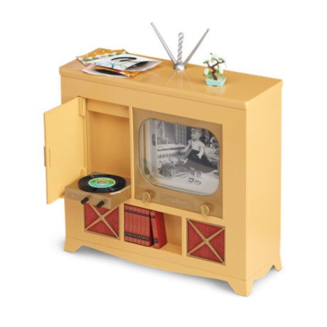 A large television console was truly the entertainment center in Maryellen's day. This set features: •A 1950s-style TV console with a built-in make-believe record player and encyclopedia books •A smal