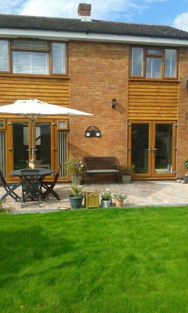 New double glazing, cladding, patio and turf. Back garden September 2014