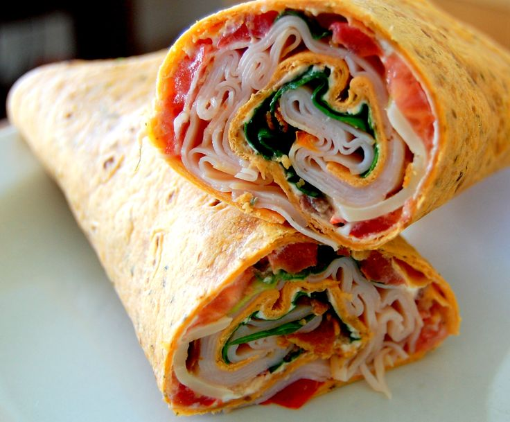 ... and lettuce rolled in sun dried tomato wrap spread with cream cheese