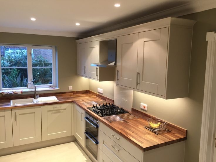 Lima Kitchens Marlow painted putty kitchen with walnut worktops and beautiful green decor