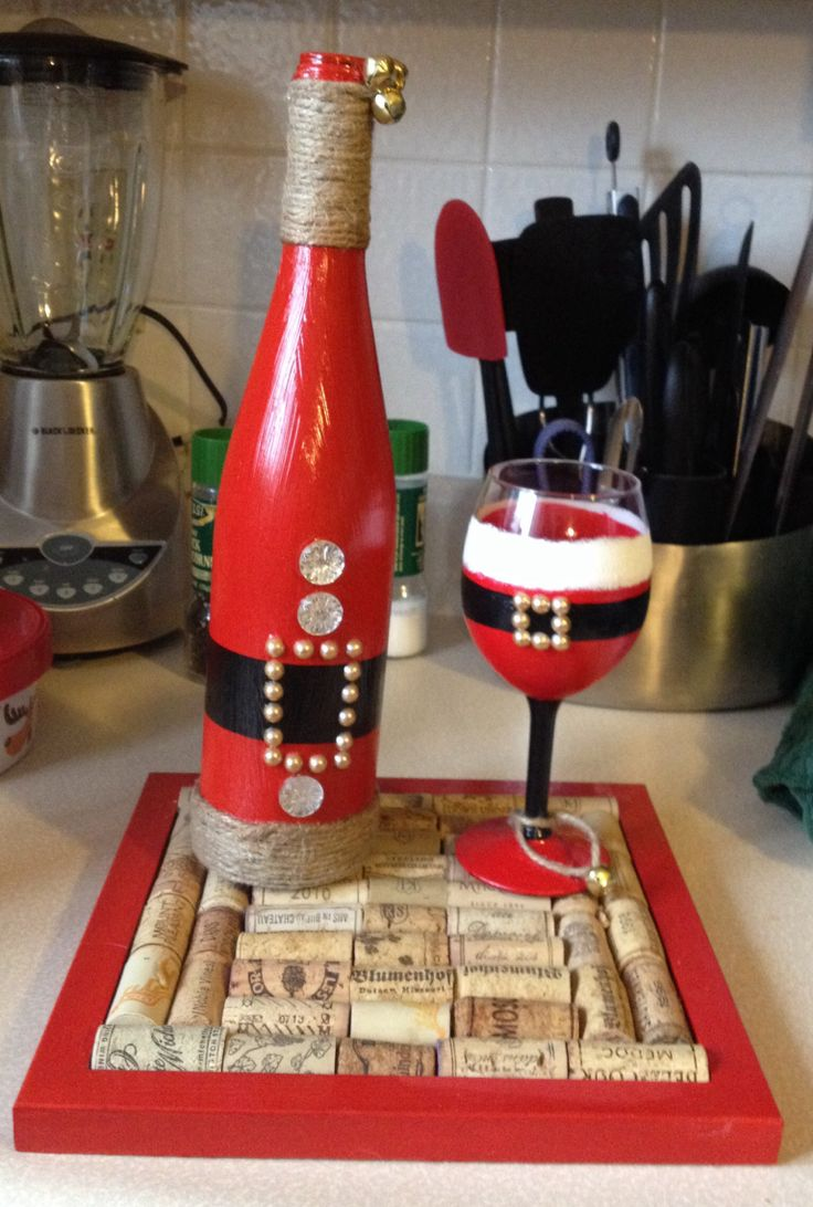 Painted Santa wine bottle and wine glass with wine cork trivet. Boyfriends moms present! DIY wine cork crafts. Used twine, acrylic glass paint, jingle bells, jewel stickers, wine corks, and mod podge.