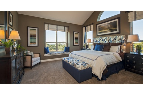Deep taupe walls with a Palladian window over the bed are distinctive touches. One of 13 new homes in the Vista Verde community by Meritage Homes in Austin, TX. #StartFreshBuyNew