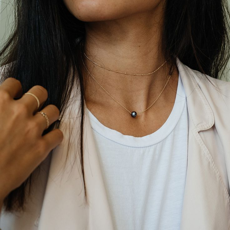 Oh so fine collection by Mejuri, 14k solid gold necklace with a fresh water pearl. handcrafted. Everyday fine jewelry.