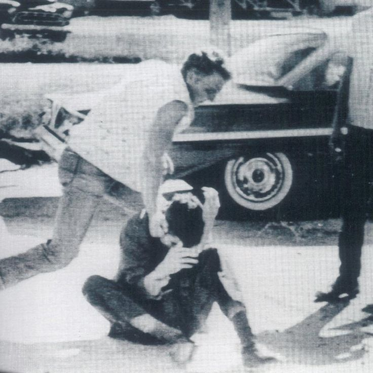 McComb, Mississippi 1961: White supremacists pull Thomas Hayden [a political activist devoted to civil rights and the anti-war movement] from a stopped car and beat him in McComb, Mississippi, in 1961.Tom Hayden Papers / University of Michigan