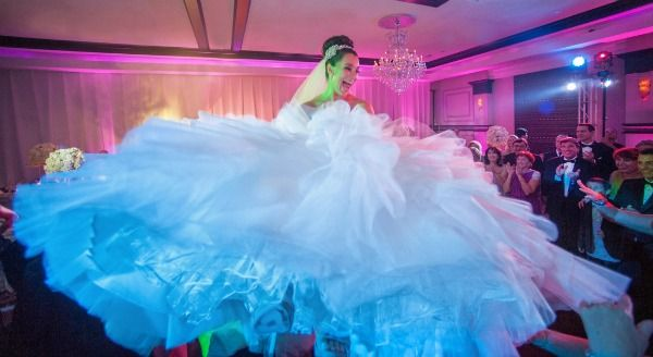 Gorgeous Shot of the Bride Enjoying the Chair Lift during her Jewish Wedding Hora {Jeff Kolodny Photography} - mazelmoments.com