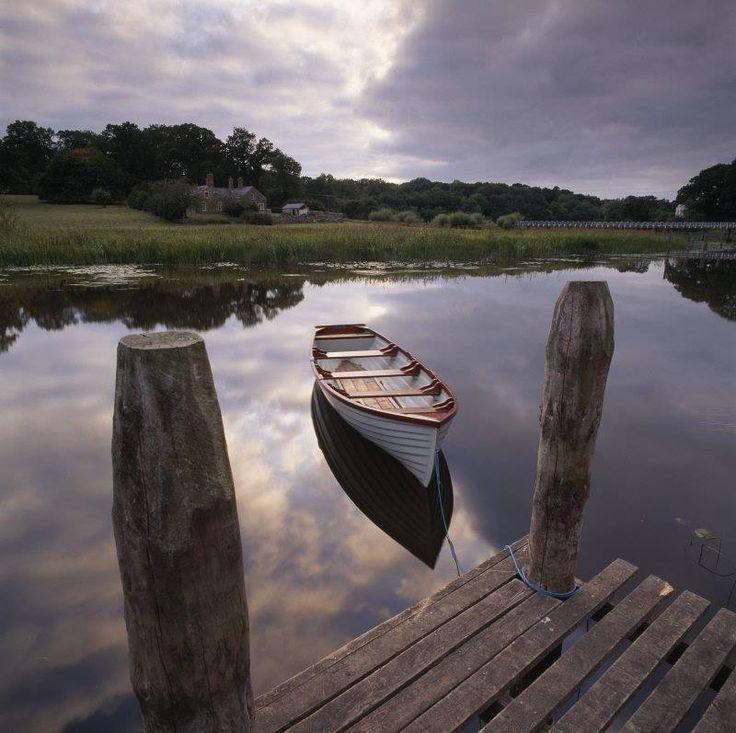 National Trust (UK), old white boat, bridge, water, trees ...
