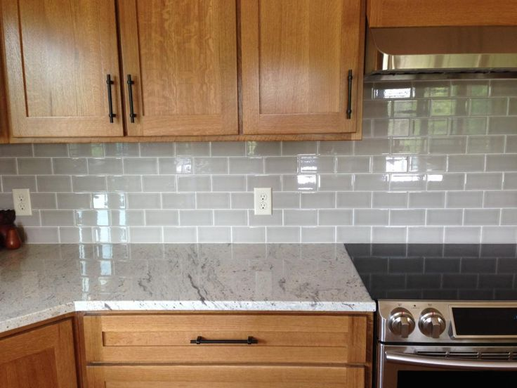 photo IMG_2399_zps68a3e642.jpg;   RIVER WHITE GRANITE;  ALLEN & ROTH PEARL BACKSPLASH; QS OAK