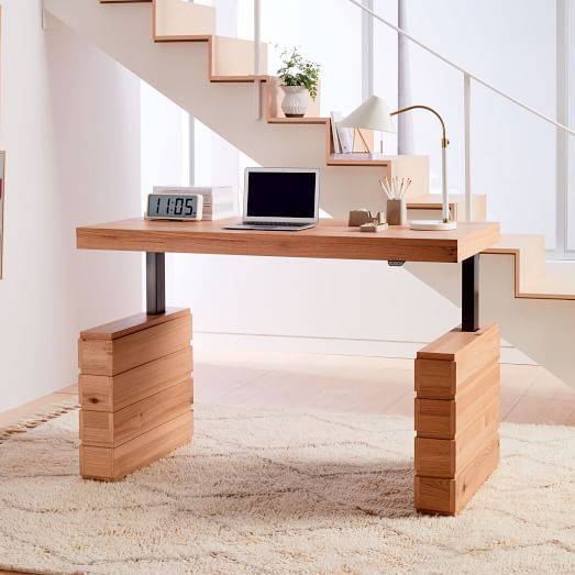 Wow! Finally an height adjustable standing desk that is actually beautiful to look at when at its lowest position. Update: The desk is no longer on West Elm's website.